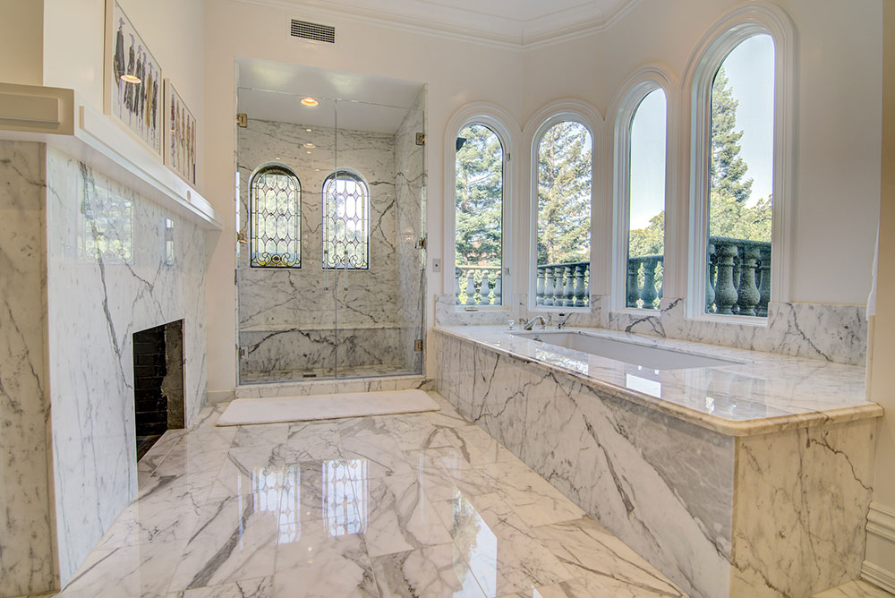 Carrera Marble Tub, Shower, & Fireplace