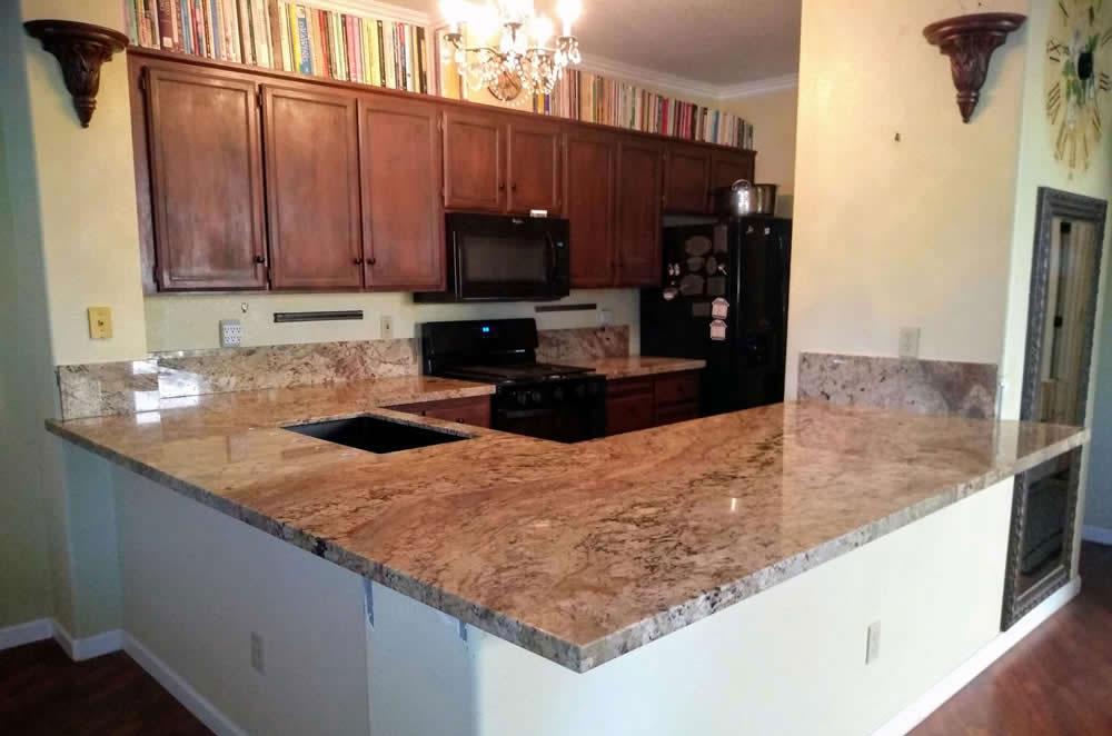 Granite Counter Tops with Tall Backsplash